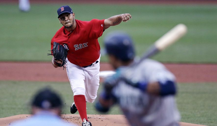Boston Red Sox starting pitcher Eduardo Rodriguez delivers during the first inning of a baseball game against the Seattle Mariners at Fenway Park in Boston, Friday, May 26, 2017. (AP Photo/Charles Krupa)