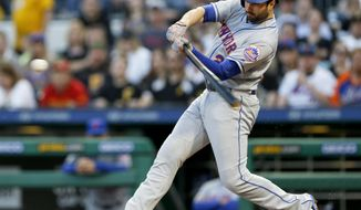 New York Mets' Neil Walker hits a two-run home run against the Pittsburgh Pirates in the third inning of a baseball game, Friday, May 26, 2017, in Pittsburgh. (AP Photo/Keith Srakocic)
