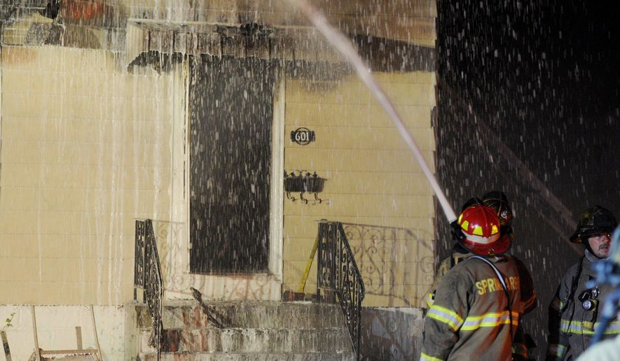Firefighters from multiple departments including Jackson, Summit and Spring Arbor work at the scene of a house fire in the 600 block of Fourth Street in the early morning hours on Friday, May 26, 2017, in Jackson, Mich. A 9-year-old girl and three firefighters who rushed into a burning home to rescue her were among those injured during the early-morning blaze Friday in southern Michigan, authorities said. (J. Scott Park/Jackson Citizen Patriot via AP)