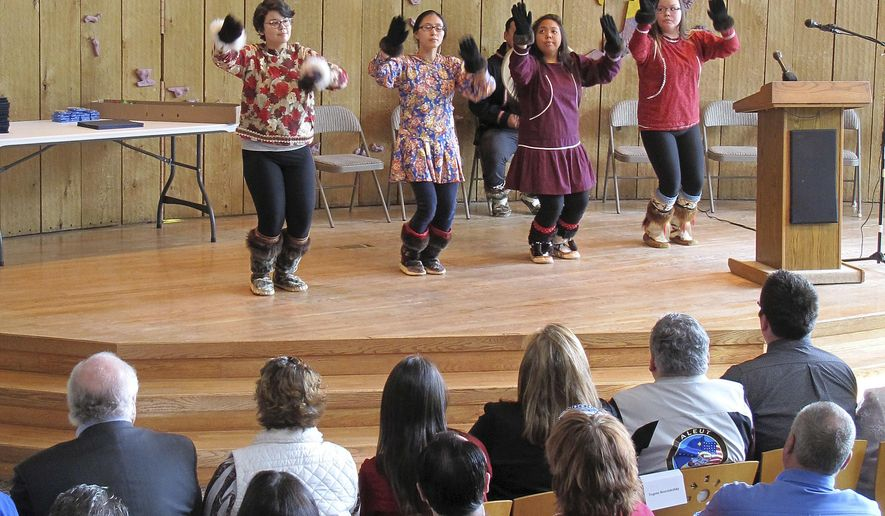 Cultural dancers perform at the Alaska Native Heritage Center, where Army honorary discharge papers were awarded to relatives of members of the Alaska Territorial Guard, a largely Native citizen militia that served to protect the U.S. territory from the threat of Japanese invasion during World War II, in Anchorage, Alaska, Friday, May 26, 2017. Relatives of 16 deceased members of the unit attended the ceremony at the Heritage Center to receive the posthumous honor. (AP Photo/Rachel D'Oro)