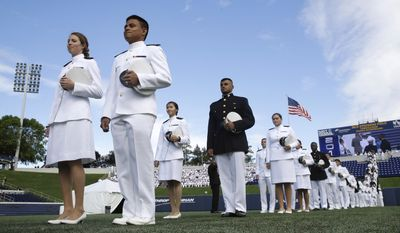 Graduating U.S. Naval Academy midshipmen march into the Academy's graduation and commissioning ceremony in Annapolis, Md., Friday, May 26, 2017.  Vice President Mike Pence is scheduled to address the graduating class at the U.S. Naval Academy. (AP Photo/Patrick Semansky)
