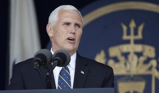 Vice President Mike Pence addresses the graduating class of U.S. Naval Academy midshipmen during the Academy's graduation and commissioning ceremony in Annapolis, Md., Friday, May 26, 2017. (AP Photo/Patrick Semansky)