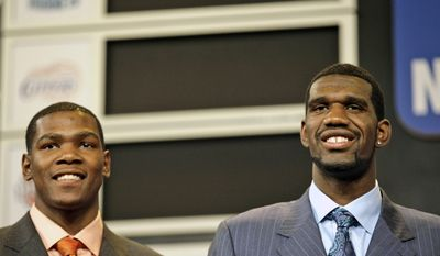 FILE - In this June 28, 2007, file photo, Texas' Kevin Durant, left, and Ohio State's Greg Oden pose before the 2007 NBA Draft in New York. Truth be told, Golden State's coach wasn't sure the Warriors needed Kevin Durant. Don Nelson thought the Warriors needed Greg Oden. That was 10 years ago, after months leading up to the heavily hyped draft in which the Oden-Durant debate raged throughout basketball. And now, as Durant leads the league's most potent team into the NBA Finals while Oden is long gone from the NBA spotlight, it's easy to forget that a lot of people agreed with Nelson. (AP Photo/Kathy Willens, File)