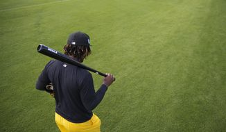 FILE - In this Feb. 14, 2017 file photo, Pittsburgh Pirates' Gift Ngoepe walks off the field after a workout at baseball spring training in Bradenton, Fla. Ngoepe made history on April 26 when he became the first African to play Major League Baseball. (AP Photo/David Goldman)