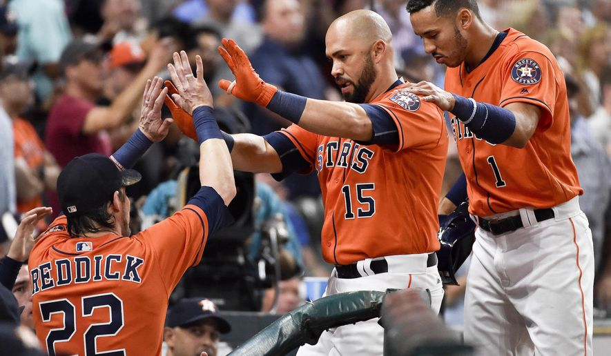 Houston Astros' Carlos Beltran (15) celebrates his solo home run off Baltimore Orioles starting pitcher Kevin Gausman with teammates Carlos Correa, right, and Josh Reddick (22) during the sixth inning of a baseball game, Friday, May 26, 2017, in Houston. (AP Photo/Eric Christian Smith)