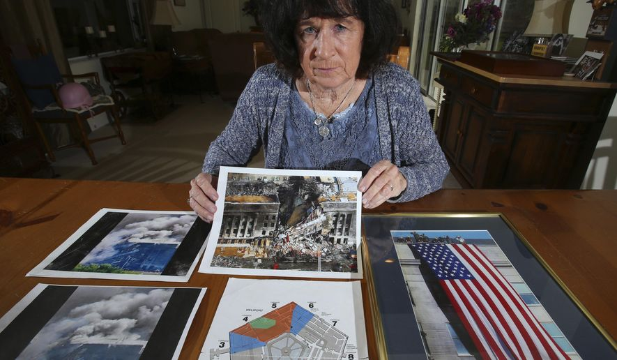 In this Thursday, March 23, 2017 photo, U.S. Army Col. Janet Horton, a retired military chaplain of 28 years, poses for a photo with pictures of the Pentagon from the Sept. 11 terrorist attack at her home in southeast Ocala, Fla. The terrorist plane struck the south side of the building where her office was, but she had been called away to get dental X-rays. Ironically, she was supposed to get them on August 11, her birthday, but the dental assistant had misplaced her file. (Bruce Ackerman/Star-Banner via AP)