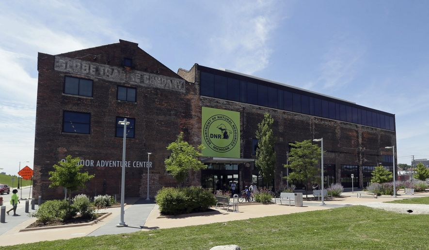 ADVANCE FOR USE SUNDAY, MAY 28 AND THEREAFTER - FILE - This July 16, 2015. file photo shows the exterior of the Department of Natural Resources Outdoor Adventure Center in Detroit. Lawmakers' bid to exert more control over how the state buys and improves land for public recreation and conservation is hitting stiff resistance from Gov. Rick Snyder's administration and sparking a constitutional conflict. (AP Photo/Carlos Osorio, File)