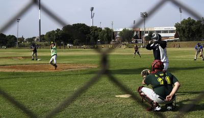 Players play a baseball practise match at Randburg Mets' park in Johannesburg, South Africa, Monday, May 8, 2017. The clubhouse was Gift Ngoepe's home, an equipment storeroom his bedroom. The field was his backyard. Never mind that Ngoepe's field of dreams was a bit patchy. And never mind that the Randburg Mets' park is hidden away on the northern outskirts of Johannesburg. (AP Photo/Themba Hadebe)