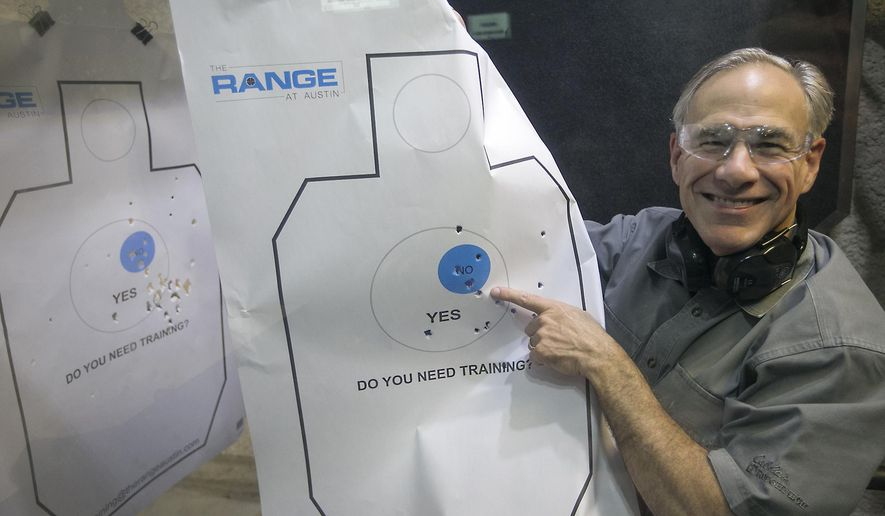 After signing into law Senate Bill 16, legislation lowering the license to carry fee, Texas Gov. Greg Abbott takes target practice as he shows his shooting prowess by displaying his target sheet to the media, at The Range in South Austin under the guidance of Director of Training Jeff Gonzales Friday, May 26, 2017.  (Ralph Barrera/Austin American-Statesman via AP)
