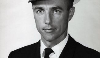 This undated photo provided by the U.S. Navy shows Lt. Commander Frederick P. Crosby in his official Navy portrait. Daughter Deborah Crosby has worked for more than half a century on getting her father's remains recovered from Vietnam after his Navy plane was shot down there in 1965. She is finally going to get to see him buried in his hometown of San Diego with full military honors. Crosby and her brothers will receive a flag-draped casket carrying the remains of Lt. Commander Crosby on Friday, May 26, 2017, in San Diego. (U.S. Navy via AP)
