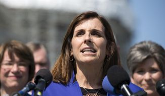 In this March 16, 2016, file photo, Rep. Martha McSally, R-Ariz., speaks on Capitol Hill in Washington. (AP Photo/Molly Riley, File)