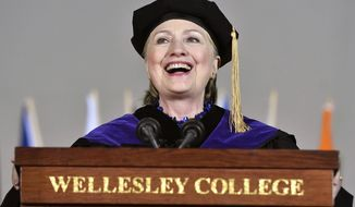 Former Secretary of State Hillary Clinton delivers the commencement address at Wellesley College, Friday, May 26, 2017 in Wellesley, Mass. Clinton graduated from the school in 1969. (AP Photo/Josh Reynolds)