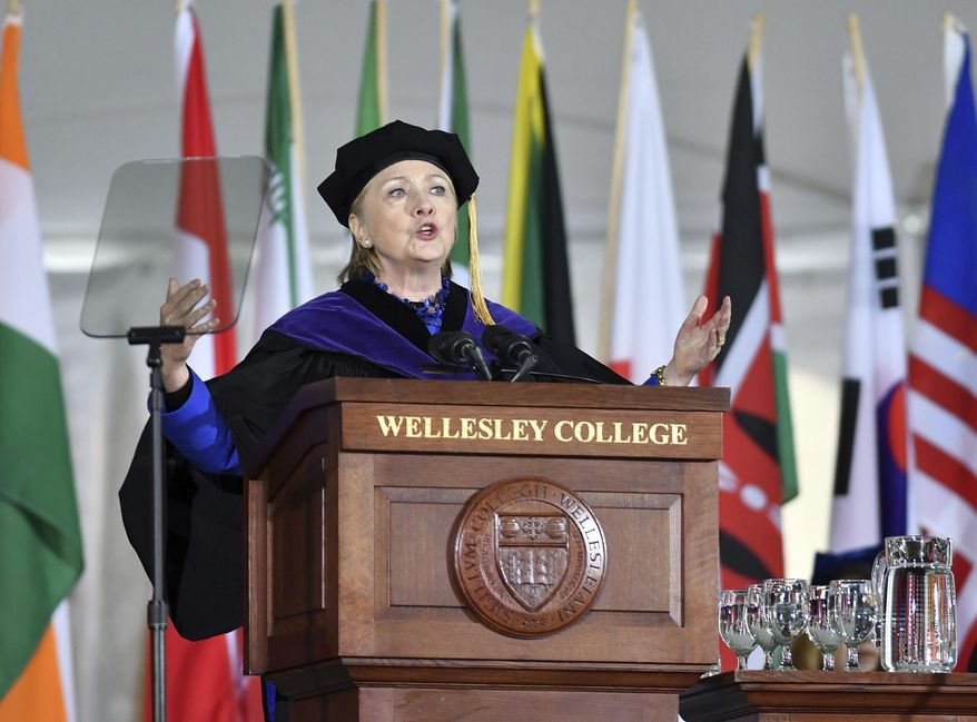 Former Secretary of State Hillary Clinton gestures after she delivered the commencement address at Wellesley College, Friday, May 26, 2017, in Wellesley, Mass. Clinton graduated from the school in 1969. (AP Photo/Josh Reynolds)