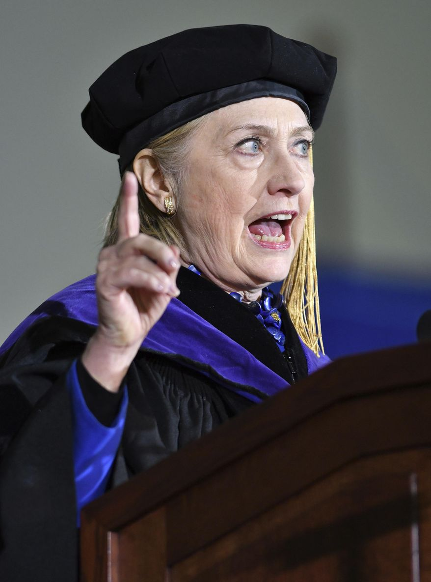 "Former Secretary of State Hillary Clinton delivers the commencement address at Wellesley College, Friday, May 26, 2017 in Wellesley, Mass.  Clinton on Friday urged the graduating class at her Massachusetts alma mater to fight against ""full-fledged assaults on truth and reason.""  (AP Photo/Josh Reynolds)"