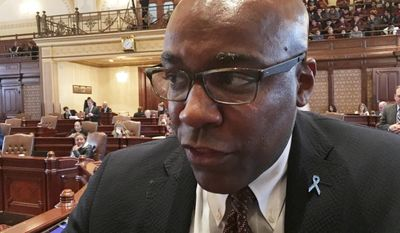 Illinois state Sen. Kwame Raoul, D-Chicago, speaks with reporters at the Capitol in Springfield on Friday, May 26, 2017. What qualifies as Illinois Democrats' spring compromise on cost-cutting changes to the workers' compensation program won Senate approval Friday, leaving derisive Republicans without a major, previously agreed-to cost-saving concession. Raoul sponsored one measure requiring state Insurance Department-approved rates based on market need. (AP Photo/John O'Connor)