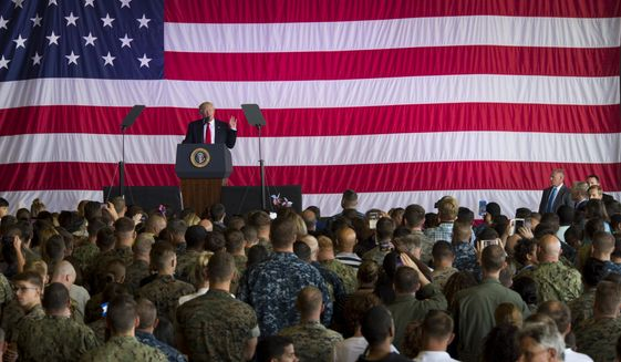"""President Trump took a victory lap during an address to U.S. troops in Italy on Saturday. """"I think we hit a home run no matter where we went,"""" Mr. Trump said at Naval Air Station Sigonella, in Sicily. (Associated Press)"""