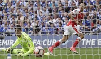 Arsenal's Alexis Sanchez, right, scores past Chelsea goalkeeper Thibaut Courtois during the English FA Cup final soccer match between Arsenal and Chelsea at the Wembley stadium in London, Saturday, May 27, 2017. (AP Photo/Matt Dunham)