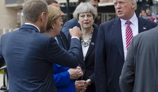 From left, President of the European Council Donald Tusk gesticulates as he talks with German Chancellor Angela Merkel, French newly elected President Emmanuel Macron, partially hidden, British PM Theresa May, and US President Donal Trump prior to the start of the leaders of the G7 countries summit in the Sicilian citadel of Taormina, Italy, Friday, May 26, 2017. On Friday and Saturday, for the first time all seven are around the same table, including also newcomers Macron, May and the Italian host, Paolo Gentiloni -- forging a new dynamic after a year of global political turmoil amid a rise in nationalism. (AP Photo/Salvatore Cavalli)