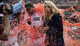 Boston Red Sox starting pitcher Brian Johnson, left, and television field reporter Guerin Austin, are doused after a baseball game against the Seattle Mariners at Fenway Park in Boston, Saturday, May 27, 2017. Johnson threw a complete game. (AP Photo/Charles Krupa)