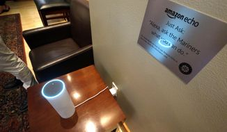 In this May 17, 2017 photo, an Amazon Alexa device is used during a demonstration of its use in a ballpark suite, before a Seattle Mariners baseball game in Seattle. The Mariners have partnered with their hometown neighbors at Amazon to create the first integration between pro sports and Amazon's Alexa voice activated platform. It's currently an extra amenity for suite holders at Safeco Field, but the expansion opportunities to upgrade the fan experience seem boundless. (AP Photo/Elaine Thompson)