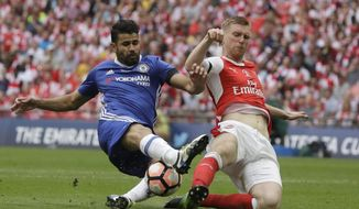 Chelsea's Diego Costa, left, challenges for the ball with Arsenal's Per Mertesacker during the English FA Cup final soccer match between Arsenal and Chelsea at the Wembley stadium in London, Saturday, May 27, 2017. (AP Photo/Matt Dunham)