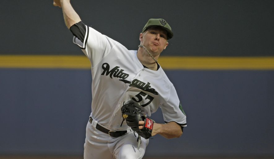 Milwaukee Brewers starting pitcher Chase Anderson throws to the Arizona Diamondbacks during the seventh inning of a baseball game Saturday, May 27, 2017, in Milwaukee. (AP Photo/Jeffrey Phelps)