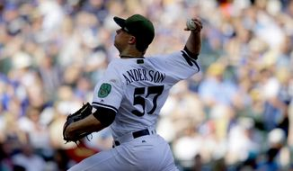 Milwaukee Brewers starting pitcher Chase Anderson throws to the Arizona Diamondbacks during the sixth inning of a baseball game Saturday, May 27, 2017, in Milwaukee. (AP Photo/Jeffrey Phelps)