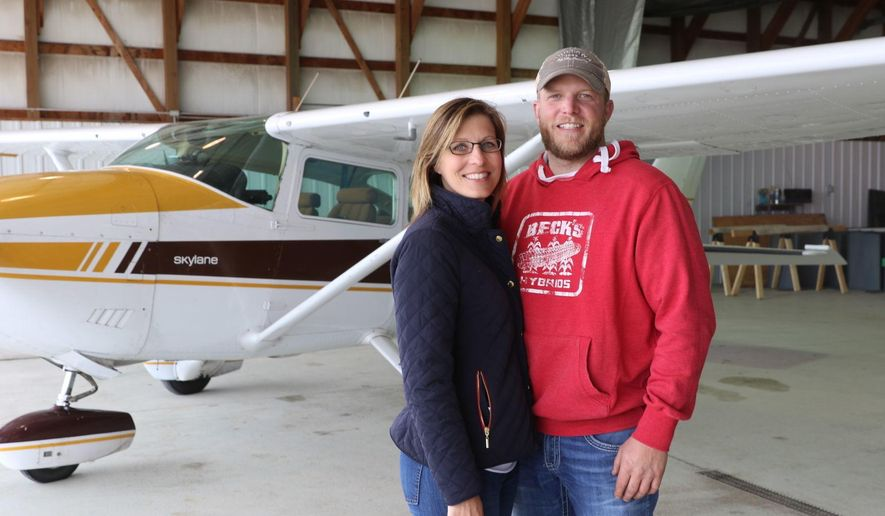FOR RELEASE SATURDAY, MAY 27, 2017, AT 12:01 A.M. CDT - In this undated photo Doug and Robyn Pralle of Hampton pose for a photo next to their Cessna 183 plane in Hampton, Iowa. The couple recently started a non-profit organization called Compassion Flights to get North Iowa patients to other locations in the Midwest for medical treatment. (Mary Pieper/Globe-Gazette via AP)