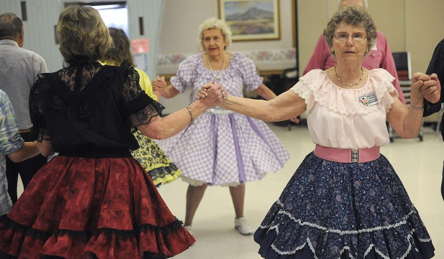 ADVANCE FOR WEEKEND EDITIONS - In this April 22, 2017, photo, Marlene Bauer swings at a Dudes 'n' Dolls dance at the Missouri River Manor in Great Falls, Mont. The club will welcome square dancers from across the state to Great Falls on Memorial Day Weekend. (Julia Moss/The Great Falls Tribune via AP)