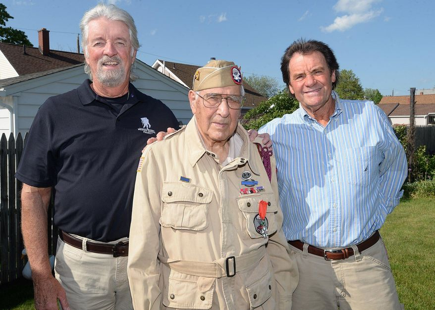 In this May 18, 2017, photo, Joseph Morettini, 92, center, of Erie, Pa., poses for a photo with his friends John Malone, left, and Bill Dunbar, right. In the early morning hours of D-Day, June 6, 1944,  Morettini, a 19-year-old paratrooper with the U.S. Army 82nd Airborne Division, jumped from a Douglas C-47 Skytrain over France's Normandy coast. (Jack Hanrahan/Erie Times-News via AP)