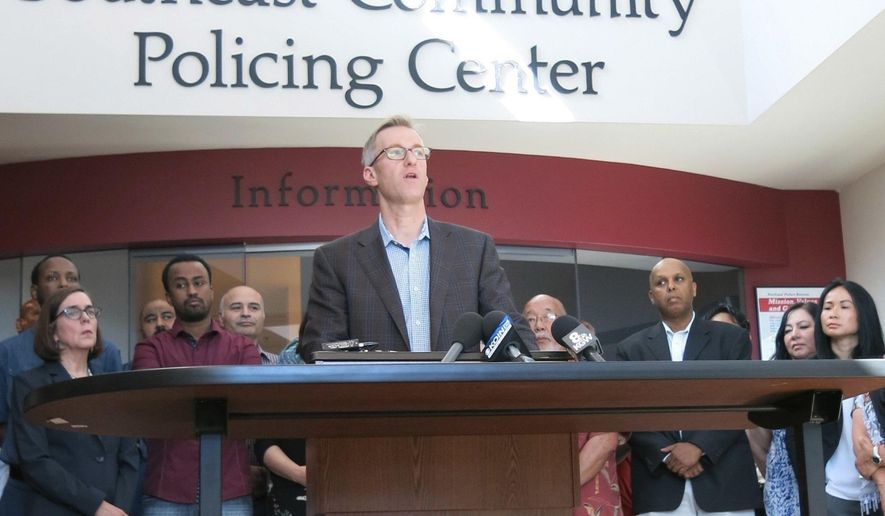 Portland Mayor Ted Wheeler speak at a news conference after a man fatally stabbed two men Friday on a light-rail train when they tried to stop him from yelling anti-Muslim slurs at two young women, one of whom was wearing a hijab, in Portland, Ore., Saturday, May 27, 2017. Jeremy Joseph Christian, 35, was booked on suspicion of aggravated murder and attempted murder in the attack and will make a first court appearance Tuesday. (AP Photo/Gillian Flaccus)