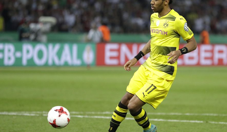 Dortmund's Pierre-Emerick Aubameyang scores his side's 2nd goal during the German soccer cup final match between Borussia Dortmund and Eintracht Frankfurt in Berlin, Germany, Saturday, May 27, 2017. (AP Photo/Michael Sohn)