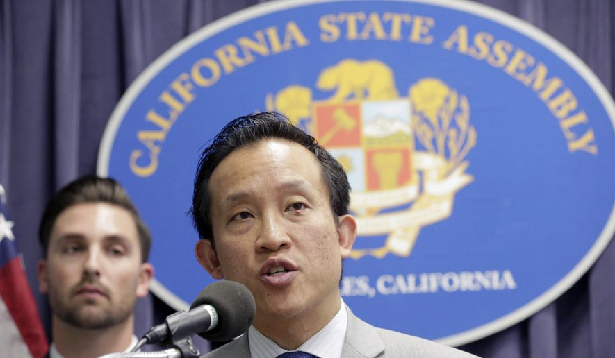FILE - In this Mar. 17, 2017, file photo, Assemblyman David Chiu, D-San Francisco, Chair of the Assembly Committee on Housing and Community Development, right, speaks in Los Angeles. California Democrats are expanding their efforts to resist President Donald Trump's crackdown on illegal immigration with bills aimed at limiting how much private business people can cooperate with federal immigration authorities. A bill that would bar landlords from disclosing tenants' immigration status passed the Assembly on Monday, May 22, 2017. A measure prohibiting employers from letting immigration agents into their worksites without a warrant cleared a key committee Friday, May 26, 2017. (AP Photo/Nick Ut, File)
