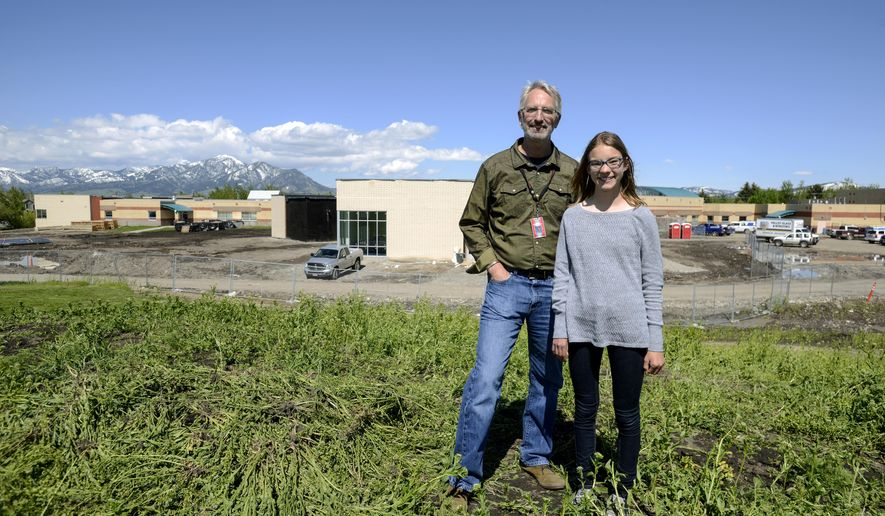 Sacajawea Principal Gordon Grissom and eighth-grader Claire Vlases, 14, worked together to raise over $115,000 so that solar panels can be installed on the roof of Sacajawea Middle School in Bozeman, Mont. The panels will go on top of the new electives wing being added to the school. (Rachel Leathe/Bozeman Daily Chronicle via AP)/Bozeman Daily Chronicle via AP)