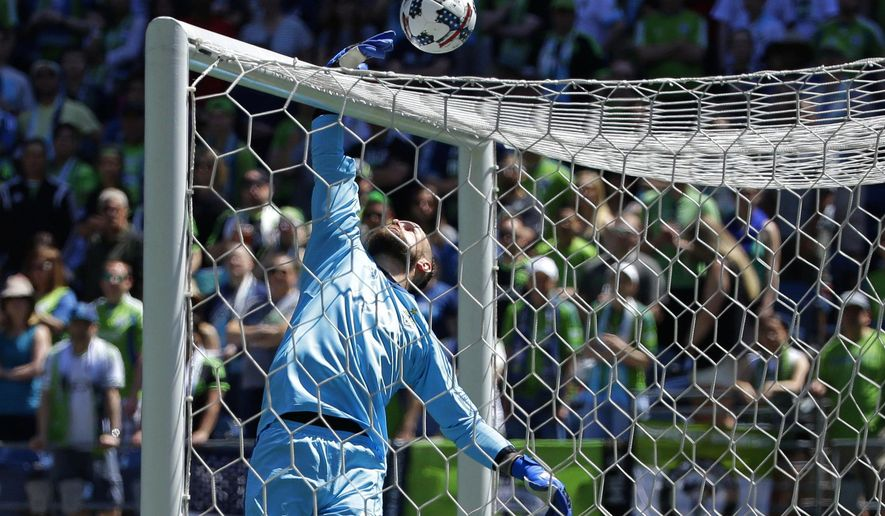 Seattle Sounders goalkeeper Stefan Frei leaps to knock a ball over the cross bar during the first half of an MLS soccer match against the Portland Timbers, Saturday, May 27, 2017, in Seattle. (AP Photo/Ted S. Warren)