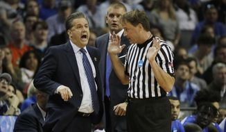 FILE - In this March 26, 2017, file photo, Kentucky head coach John Calipari argues a call with referee John Higgins in the first half of the South Regional final game against North Carolina in the NCAA college basketball tournament in Memphis, Tenn.  Seven people who threatened Higgins after an NCAA Tournament game in March have been identified. Information on them will be referred to authorities in their jurisdictions and to the FBI's Omaha field office, a Nebraska prosecutor said Friday, May 26.  (AP Photo/Mark Humphrey, File)