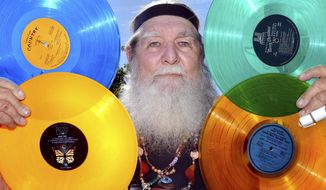 Charles Rice of Medford is selling off his 260,000-item record collection which includes thousands of brightly-colored albums he passionately collected over many decades. (Denise Baratta /The Medford Mail Tribune via AP)