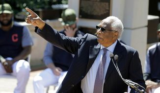 Frank Robinson speaks after his statue was unveiled before a baseball game between the Kansas City Royals and the Cleveland Indians, Saturday, May 27, 2017, in Cleveland. Robinson was MLB's first African-American manager. He became a player-manager for the Indians in 1975. (AP Photo/Tony Dejak) **FILE**