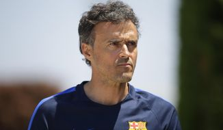FC Barcelona's coach Luis Enrique attends a press conference at the Sports Center FC Barcelona Joan Gamper in Sant Joan Despi, Spain, Friday, May 26, 2017. FC Barcelona will play against Alaves in the Spanish Copa del Rey soccer final on Saturday. (AP Photo/Manu Fernandez)