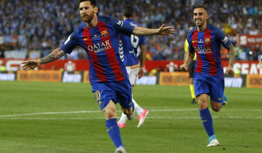 Barcelona's Lionel Messi, left, celebrates next to Barcelona's Paco Alcacer after scoring a goal during the Copa del Rey final soccer match between Barcelona and Alaves at the Vicente Calderon stadium in Madrid, Spain, Saturday May 27, 2017. (AP Photo/Daniel Ochoa de Olza)