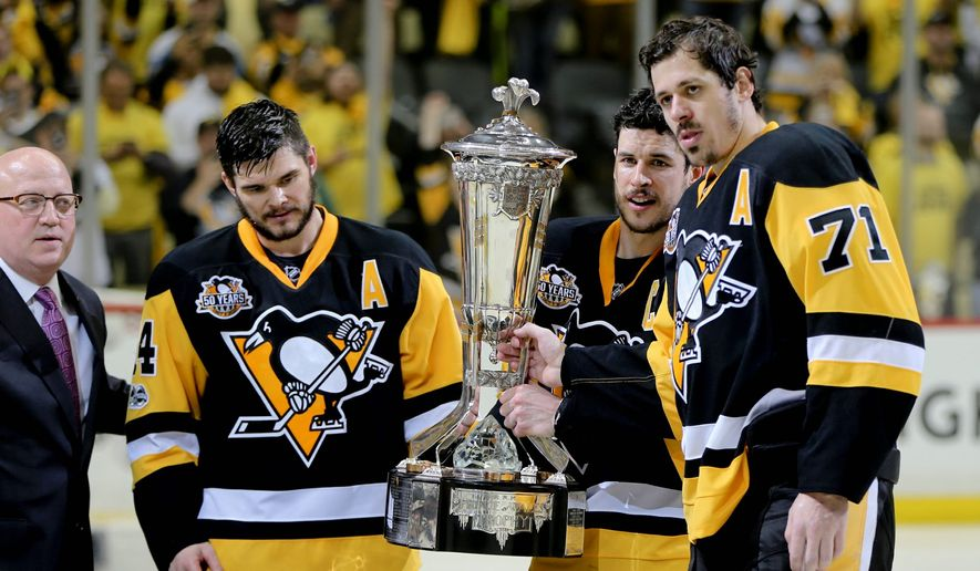 Left wing Chris Kunitz (from left) and centers Sidney Crosby and Evgeni Malkin will try to help the Pittsburgh Penguins become the first franchise win back-to-back championships in 20 years when the Stanley Cup Finals begin Monday. (Associated Press)