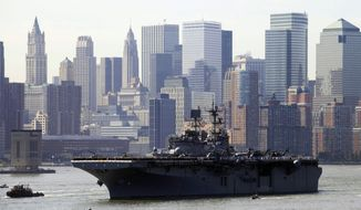 FILE - In this May 26, 2010, file photo, sailors line the deck of the USS Iwo Jima as it passes the lower Manhattan skyline on arrival in New York Harbor for the start of Fleet Week. After a year's absence, Fleet Week is coming back to New York City. Three Navy ships and two Coast Guard cutters are scheduled to arrive in New York Harbor on Wednesday, May 21, 2014, the start of the week. (AP Photo/Mark Lennihan, File)
