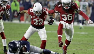 Arizona Cardinals defensive back D.J. Swearinger (36) celebrates his defensive stop after Seattle Seahawks running back C.J. Prosise (22) falls short of a first down during the second half of a football game, Sunday, Oct. 23, 2016, in Glendale, Ariz. (AP Photo/Rick Scuteri)