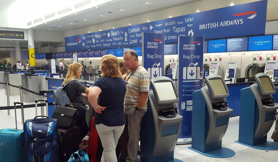 Passengers stand at the British Airways check-in desk after the airport suffered an IT systems failure, at London''s Gatwick Airport, Saturday, May 27, 2017. (Gareth Fuller/PA via AP) ** FILE **