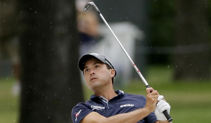 Kevin Kisner watches his approach shot on the eighth hole during the final round of the Dean & DeLuca Invitational golf tournament at Colonial Country Club in Fort Worth, Texas, Sunday, May 28, 2017. (AP Photo/LM Otero)