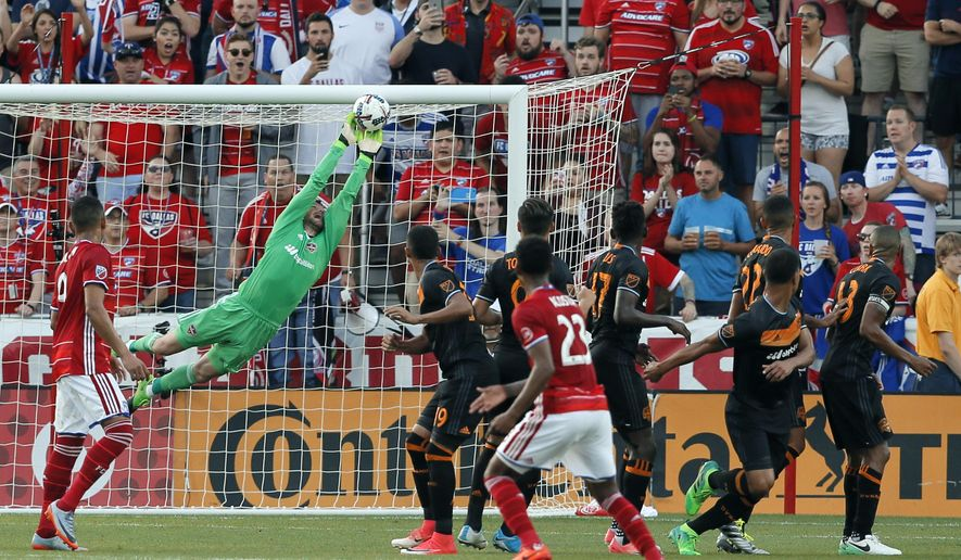 CORRECTS TO SAY FREE KICK, NOT PENALTY KICK - Houston Dynamo goalkeeper Tyler Deric (1) stretches out to make a save on a free kick by FC Dallas in the first half of an MLS soccer game, Sunday, May 28, 2017, in Frisco, Texas. (AP Photo/Tony Gutierrez)