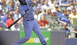 Milwaukee Brewers' Domingo Santana hits a grand-slam against the Arizona Diamondbacks during the fourth inning of a baseball game Sunday, May 28, 2017, in Milwaukee. (AP Photo/Jeffrey Phelps)