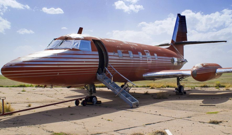 FILE - This undated file photo provided by GWS Auctions, Inc. shows a private jet once owned by Elvis Presley, on a runway in New Mexico. The plane has been auctioned after sitting on a runway in New Mexico for 35 years. The plane sold for $430,000 on Saturday, May 27, 2017, at an Agoura Hills, Calif., event featuring celebrity memorabilia, GWS Auctions Inc. said. (GWS Auctions, Inc. via AP, File)