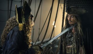 "In this image released by Disney, Geoffrey Rush portrays Barbossa, left, and Johnny Depp portrays Captain Jack Sparrow in a scene from ""Pirates of the Caribbean: Dead Men Tell No Tales."" (Peter Mountain/Disney via AP)"