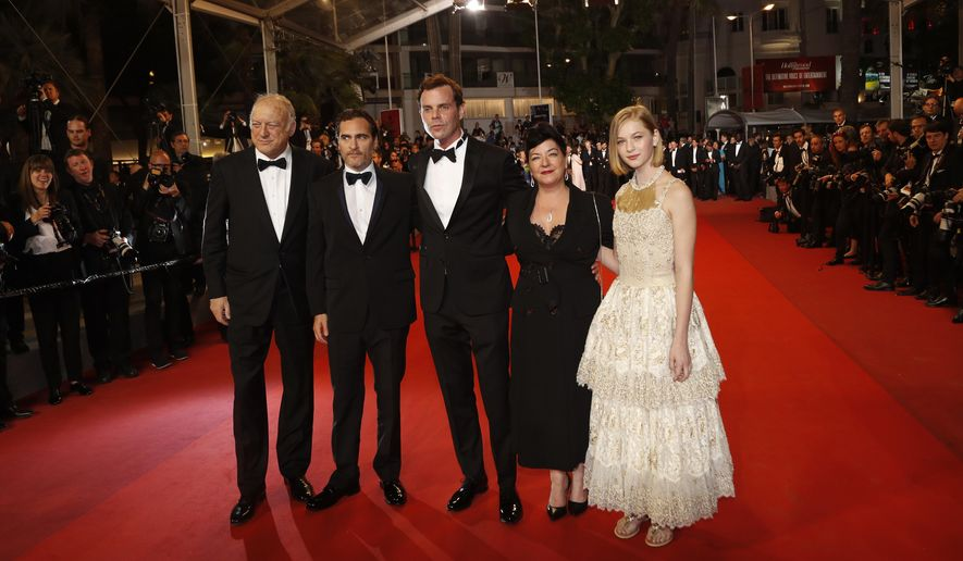 Actors John Doman, from left, Joaquin Phoenix, Alex Manette, director Lynne Ramsay and Ekaterina Samsonov pose for photographers upon arrival at the screening of the film You Were Never Really Here at the 70th international film festival, Cannes, southern France, Saturday, May 27, 2017. (AP Photo/Thibault Camus)